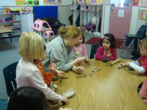 Riverbend Montessori staff playing with kids